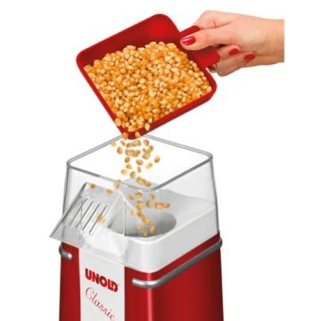 Der Deckel des Unold Popcornmaker Classic als Messbecher